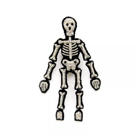 Broche Mueve el esqueleto